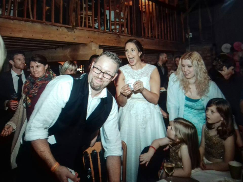 Magican Yo performing Magic at a wedding with many guests